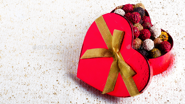 Heart-shaped box with chocolates. Handmade candies. Copy space - Stock Photo - Images