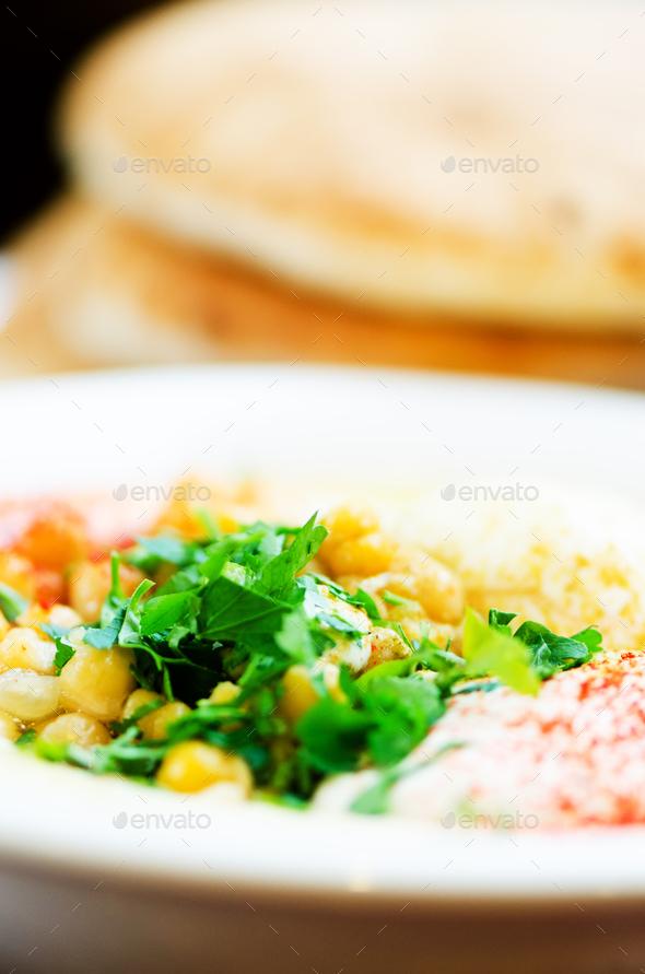 Classic hummus with parsley and pita. Traditional jewish food and middle eastern cuisine recipe - Stock Photo - Images