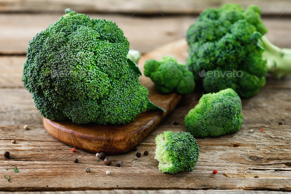Fresh organic broccoli on wooden table close up - Stock Photo - Images