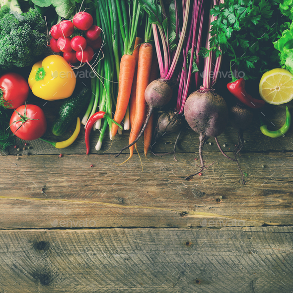 Vegetables on wooden background. Bio healthy organic food, herbs and spices. Raw and vegetarian - Stock Photo - Images