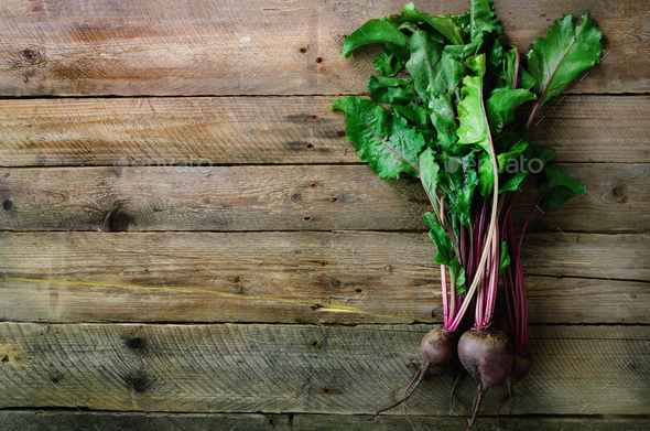 Bunch of fresh organic beetroot on wooden background. Concept of diet, raw, vegetarian meal. Farm - Stock Photo - Images