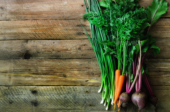 Fresh vegetables - carrots, beetroots, green onion on wooden background. Harvest. Concept of diet - Stock Photo - Images