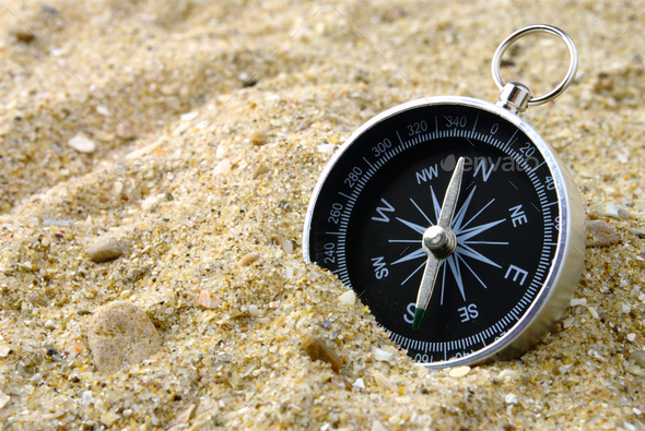 Compass and sand - Stock Photo - Images