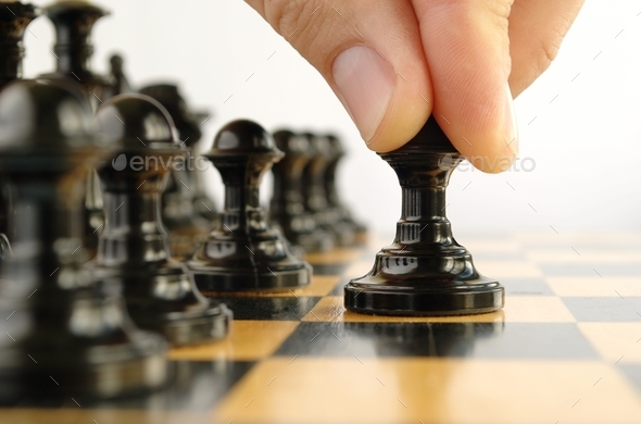 man playing chess - Stock Photo - Images
