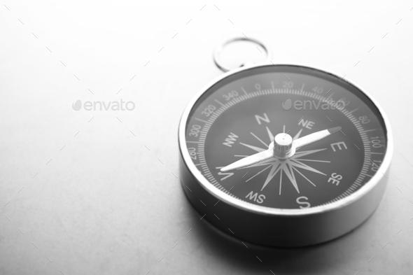 Compass on a gray gradient background, place for text - Stock Photo - Images