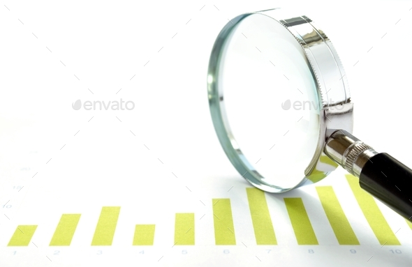 chart and a magnifying glass - Stock Photo - Images