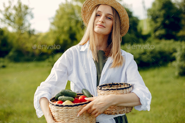 Beautiful woman in a summer field - Stock Photo - Images