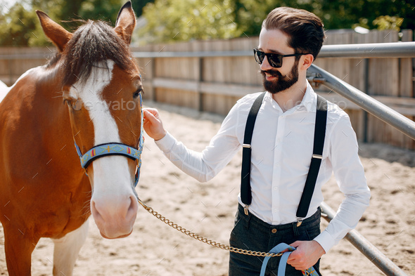 Handsme man standing in a ranch - Stock Photo - Images