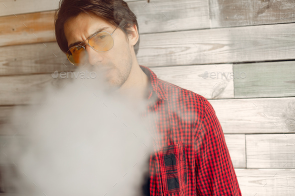 Stylish and elegant man in a city with vape - Stock Photo - Images
