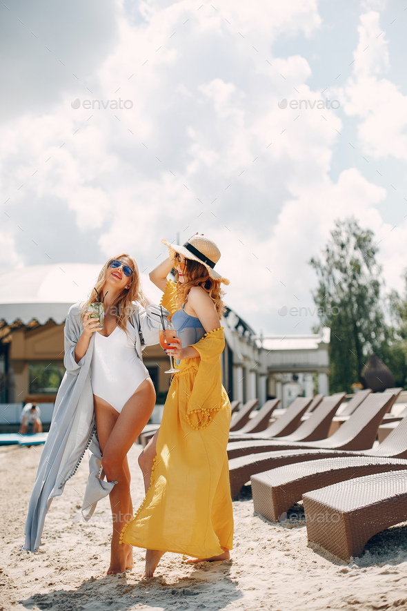 Two elegant girls on a resort - Stock Photo - Images