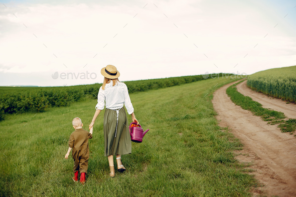 Beautiful mother with little son in a summer field - Stock Photo - Images