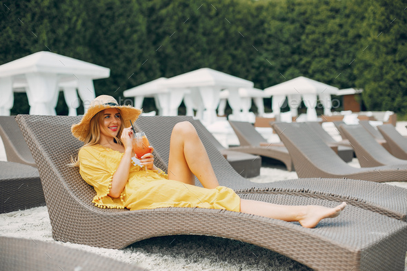 Beautiful and elegant girl on a resort - Stock Photo - Images