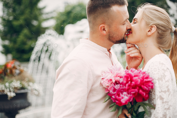 Beautiful couple spend time in a summer garden - Stock Photo - Images