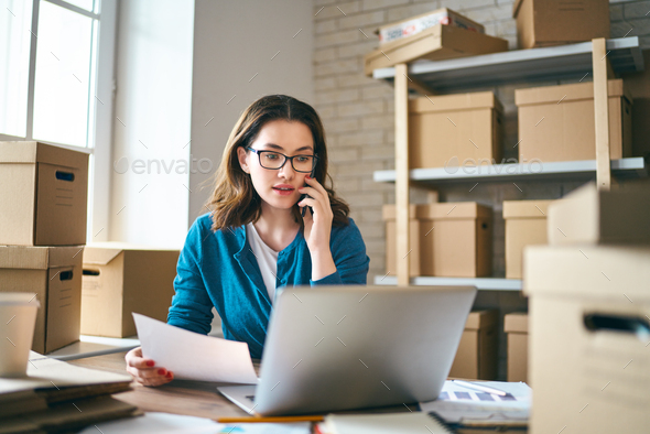Woman is working at warehouse for online store. - Stock Photo - Images