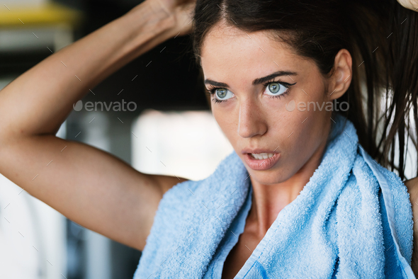 Portrait of beautiful young sport woman with towel - Stock Photo - Images
