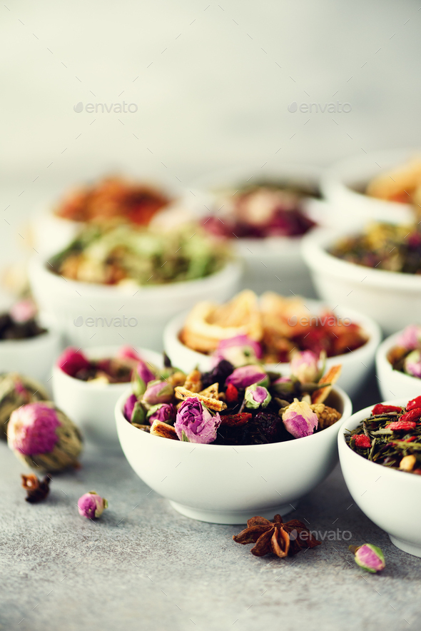Assortment of dry tea in white bowls. Tea types backgound: green, black, floral, herbal, mint - Stock Photo - Images