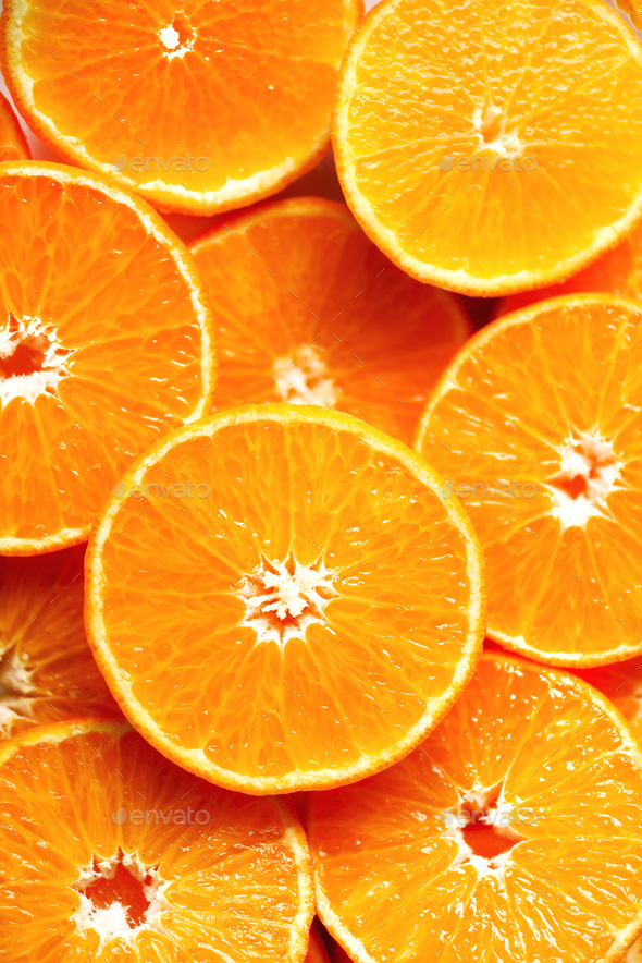 Fresh sliced orange fruit texture. Macro, top view, copy space. Food frame. Juicy oranges background - Stock Photo - Images