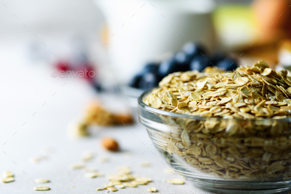 Oatmeal, oat flakes on grey concrete background. Copy space. Healthy breakfast concept - Stock Photo - Images