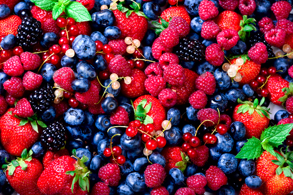 Macro colorful berries background. Top view. Summer food frame, border design. Assorted mix of - Stock Photo - Images
