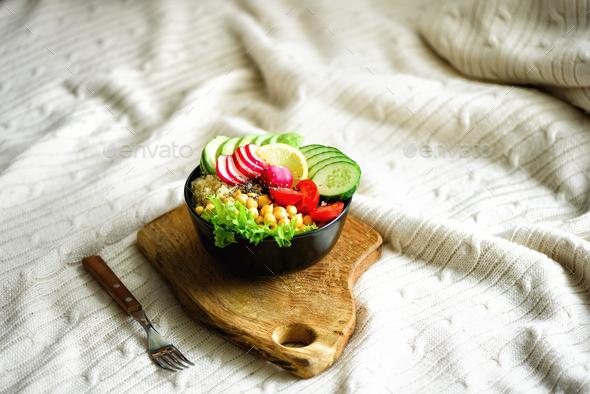 Buddha bowl with avocado, quinoa, cucumber, radish, salad, lemon, cherry tomatoes, chickpea, chia - Stock Photo - Images