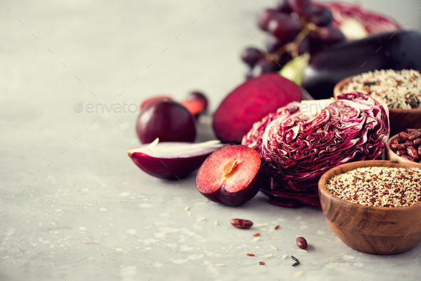 Ingredients for cooking, copy space, top view, flat lay. Purple vegetables, fruits on grey - Stock Photo - Images