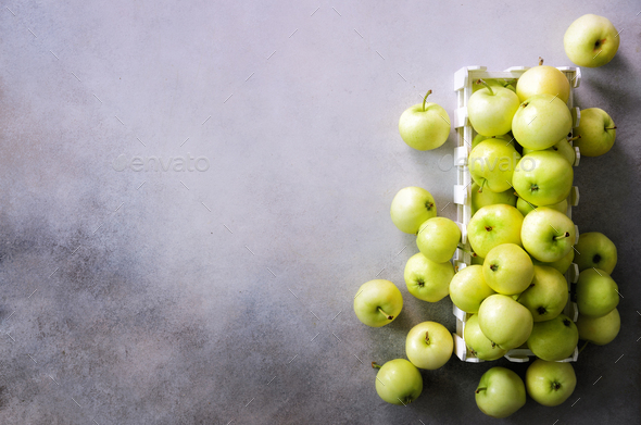Fresh green apples in wooden box on light grey background. Free space for text. Copy space. Top view - Stock Photo - Images