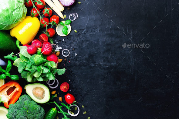 Set of fresh vegetables on a black background. Aromatic herbs, onion, avocado, broccoli, pepper bell - Stock Photo - Images