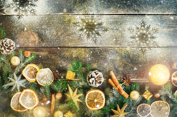 Christmas greeting card with gifts, candle, cones, cinnamon sticks, dry orange, green tree over old - Stock Photo - Images