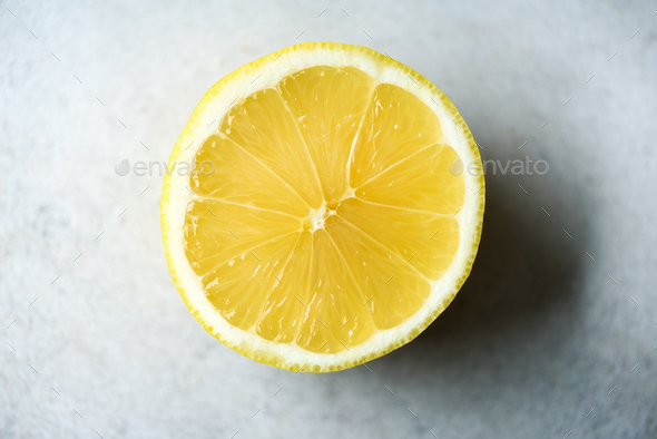 Lemon sliced half on grey background. Citrus fruit macro. Copy space, top view - Stock Photo - Images