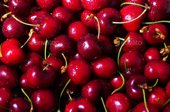 Red cherries background with water drops. Top view. Summer and harvest concept. Vegan, vegetarian - Stock Photo - Images