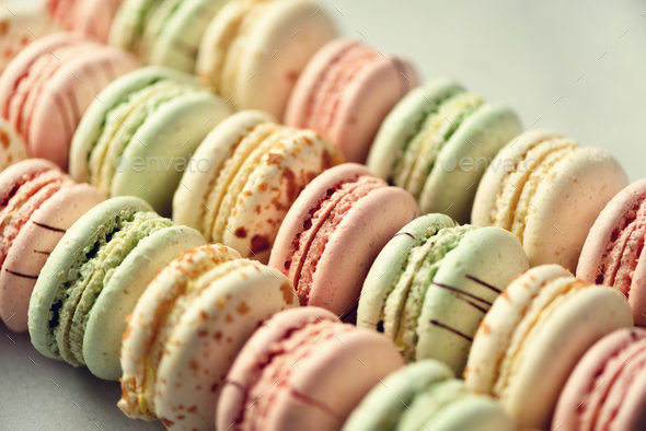Colorful french macaroons flat lay. Pastel colors pink, green, yellow macarons with copy space, top - Stock Photo - Images