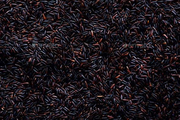 Raw dark red, balck purple rice, texture. Riceberry pattern background. Food ingredient background - Stock Photo - Images