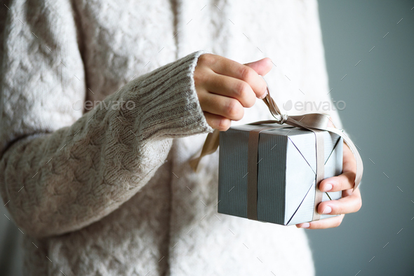 Female hands holding gift box. Copy space. Christmas, hew year, birthday concept - Stock Photo - Images