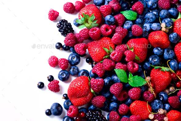 Assortment of strawberry, blueberry, currant, mint leaves. Food frame, border design. Vegan and - Stock Photo - Images