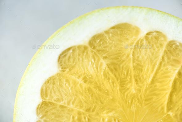 Lemon sliced half on grey background. Citrus fruit macro. Copy space, top view - Stock Photo - Images
