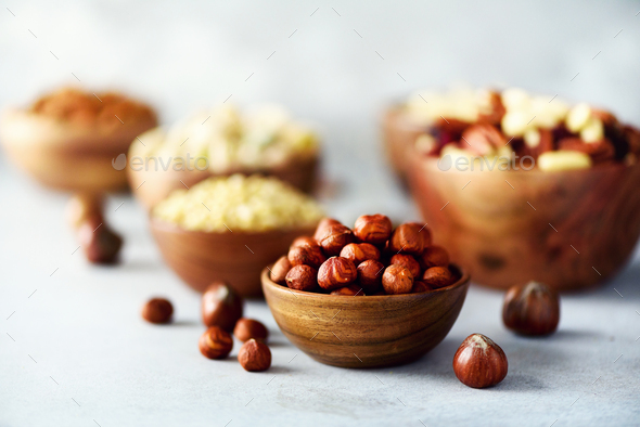 Hazelnuts in wooden bowl. Food mix background, top view, copy space, banner. Assortment of nuts - - Stock Photo - Images