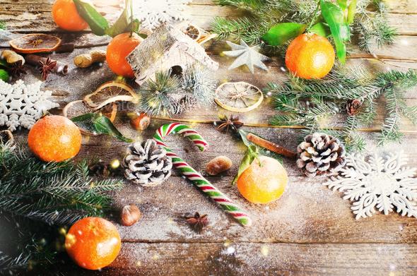 Magic Christmas background - vintage wood, candy cane, house, cinnamon, star anise, sweet mandarins - Stock Photo - Images