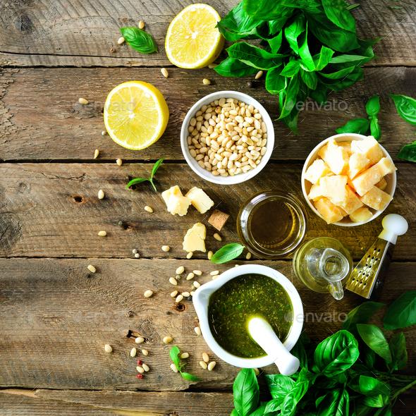 Ingredients for homemade pesto - basil, lemon, parmesan, pine nuts, garlic, olive oil and salt on - Stock Photo - Images