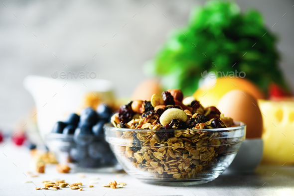 Homemade granola with milk, fresh berries, milk for breakfast. Copy space. Healthy breakfast concept - Stock Photo - Images