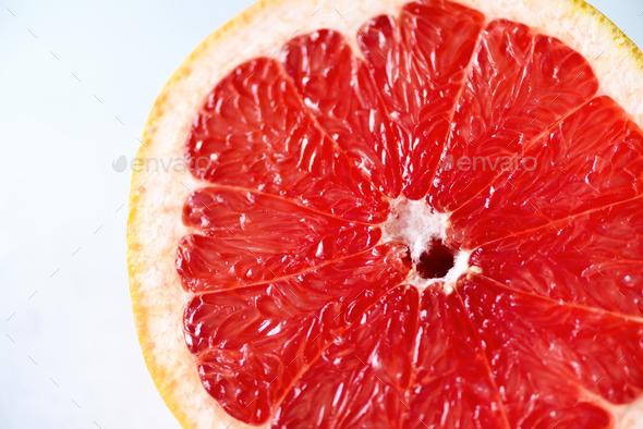 Grapefruit sliced half on grey background. Citrus fruit macro. Copy space, top view - Stock Photo - Images