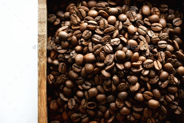 Raw and roasted coffee beans in wooden box. Ingredients for coffee beverage. Food background - Stock Photo - Images