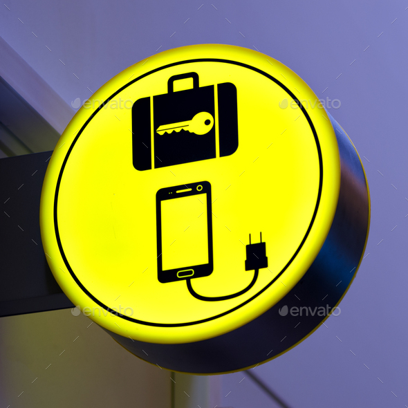 Charging mobile, cellphone battery icon in public area, airport. Locker luggage sign. Copy space - Stock Photo - Images