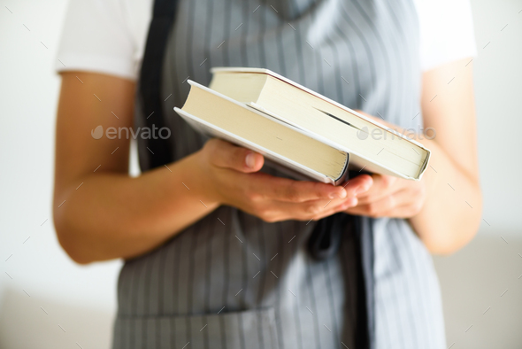 Young girl in white T-shirt reading opened book. Copy space. lifestyle and school concept - Stock Photo - Images