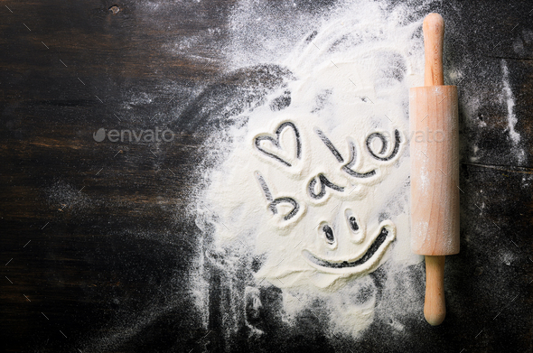 Baking background. Heart of flour, text Cook and rolling pin on dark table with copy space, top view - Stock Photo - Images