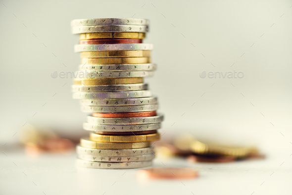 Euro money, currency. Success, wealth and poverty, poorness concept. Euro coins stack on grey - Stock Photo - Images