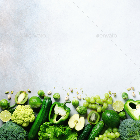 Organic green vegetables and fruits on grey background. Copy space, flat lay, top view. Green apple - Stock Photo - Images