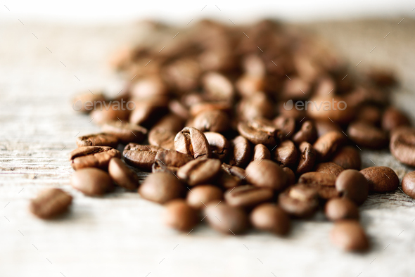 Coffee beans on light wooden background with copyspace for text. Coffee background, food frame - Stock Photo - Images