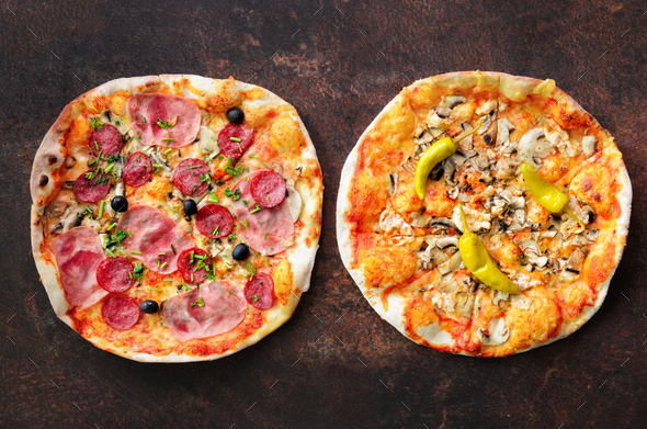 Homemade pizza. Top view with copy space on dark stone table - Stock Photo - Images