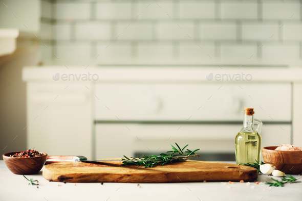 Food cooking ingredients on white kitchen design interior background with rustic wooden chopping - Stock Photo - Images