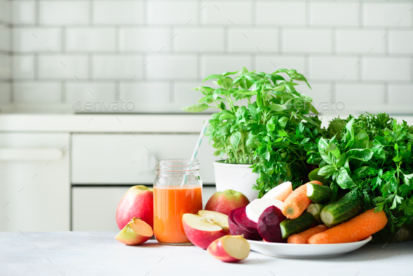 Fresh juice or smoothie, fruits and vegetable - apples, carrot, beet, celery, cucumber, greens - Stock Photo - Images